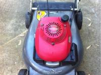 Honda push mower that is self propelled runs good and