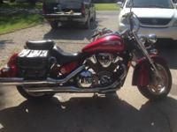 Beautiful bike! 2004 Honda vtx 1800. Includes 2 helmets