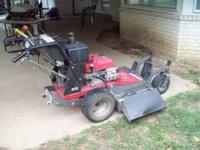"Honda Commerical 36""cut walk behind mower that is in"