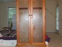 Honey Oak 8 Gun Cabinet With Light. Double glass doors