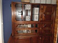 A cherry wood Hooker Entertainment Center in EXCELLENT