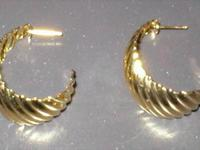 These hoop earrings have waves going across them. They