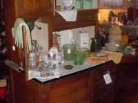 This hoosier cabinet is a must view product! It stands