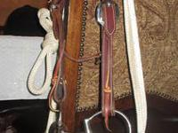 We have a very nice horse bridle and blanket .Bridle