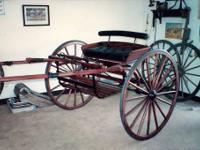 "42"" high wooden wheel show cart. Made by Heartwood"