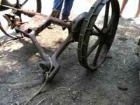 Old fashion hay cutter axle with two wheels and shaft