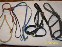several halters (6) 1 bosal, 1 set of barrel reins. You