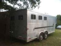2002 Exxis 2 horse slant load. Custom living quarters