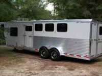 I am selling my 2007 4 horse slant load with living