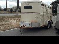 This is a 1987 circle J 3 place slant small horse