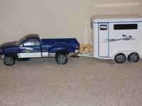White Breyer two-horse trailer. Holds standard sized