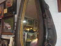 "MIRROR MADE FROM STEED COLLAR WITH HAMES  25""X 18""."