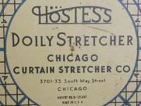 HOSTESS DOILY STRETCHER. PROBABLY FROM THE 1940'S -