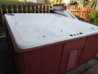 Large older hot tub for sale. This hot tub is in good