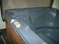 Early 2000 model hot tub, seats 6, very good condition.