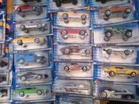 43 Hot Wheels still in packaging. Classic and Muscle