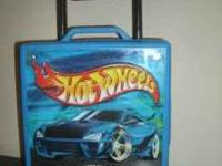 This is a cool Hotwheels case that is on wheels. It is