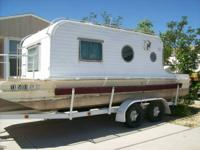1960 Terra Marina older model house boat with trailer.