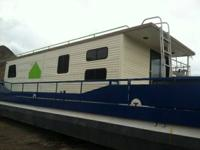 THIS HOUSEBOAT HAS NEVER BENN IN WATER IT WAS A MODEL