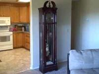Howard Miller grandfather clock. Fully functioning.