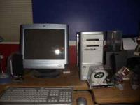 HP computer, monitor, keyboard, and mouse. 1.24 GB RAM