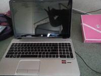 An hp envy m6 w/ beats audio, finger print scanner, amb