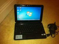 This is a black HP Mini 210-1010nr series netbook with