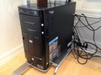 Available is a used HP Pavilion Media Center PC tower.
