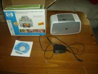 I an selling an HP photosmart A433 portable photo