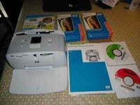 Have a HP Photosmart 325. Prints 4x6 photos. Included