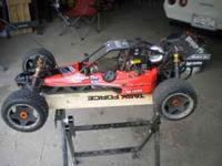 FIRST OFF THIS A VERY FAST AND BIG R/C CAR IT IS 1/5