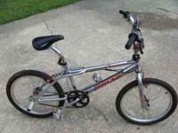 CHROME AND RED TRIMED BMX HUFFY BRAND USED VERY LITTLE