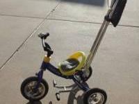 "Up for sale I have our ""Huffy Canopy Trike."" It's a"