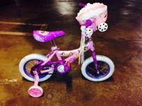 "I have a fresh Huffy Disney Princess 12"" bike with"