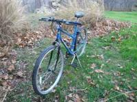 This is a Huffy Rock Ridge 10-speed mountain bike. It