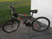 Mens Huffy stone mountain bike 18 spd. with speedometer