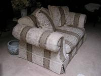 A beautiful upholstered oversized chair (size of a