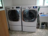 Huge, high efficiency white front loading LG washer and