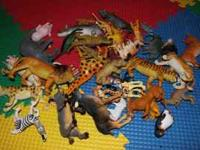 Tons of plastic animals some farm, some wild. Lions,