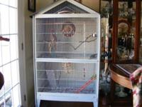 THIS IS A REALLY NICE ROOMY CAGE FOR MULTIPLE FINCHES,