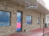 Large commerical building with 2 extra lots for sale in