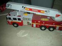 Huge fire truck, with all sorts of lights & sounds and