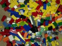 Over 2000 like new Legos, 8 mini figures, 1 base board,