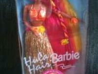 Brand new Barbie doll in box. First $10 gets doll. Call