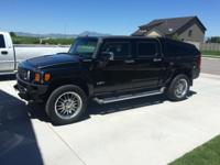 2009 Hummer H3T. Black exterior with black leather.