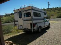 This is a camper for a long bed truck. It is a late 80s