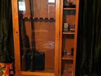 Weapon Cabinet holds 8 long weapons, bottom cabinet
