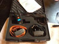 Dogtra 1702 NCP 2-dog e-collars with transmitter. This