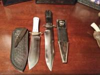 A number of kinds of hunting knives for sale. All are