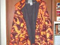 I HAVE 2 HUNTING COATS MEN 1 IS A SIZE MED REVERSIBLE